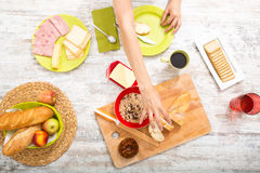 Young woman preparing a european breakfast Stock Photography