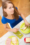 Young woman preparing a european breakfast Stock Photos