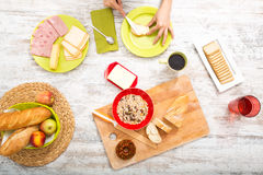 Young woman preparing a european breakfast Royalty Free Stock Photography