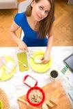 Young woman preparing a european breakfast Stock Photos