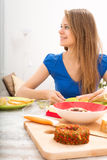 Young woman preparing a european breakfast Royalty Free Stock Photos