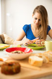 Young woman preparing a european breakfast Royalty Free Stock Images