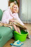 Young woman preparing feet for pedicure Stock Photography
