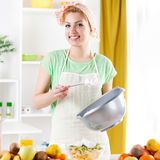 Young woman preparing fruit salad Stock Photo