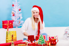 Young woman preparing gifts for Christmas Royalty Free Stock Image