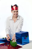 Young woman preparing gits. Pretty young woman preparing gifts and decorations for Christmas or a birthday party Royalty Free Stock Images