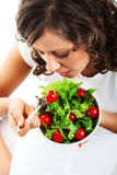 Young woman preparing healhty salad Stock Photos