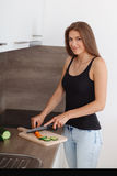 Young woman preparing a healthy meal of fresh vegetables and fruits. Stock Photography