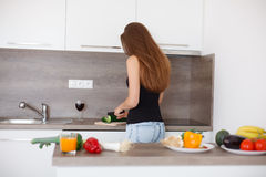 Young woman preparing a healthy meal of fresh vegetables and fruits. Royalty Free Stock Photo