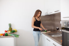 Young woman preparing a healthy meal of fresh vegetables and fruits. Stock Image