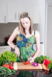 Young woman preparing healthy vegetables Stock Images