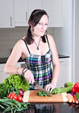Young woman preparing healthy vegetables Royalty Free Stock Image