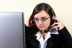 Young woman preparing for help desk work Royalty Free Stock Image