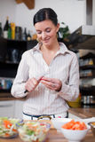 Young woman preparing lunch Stock Photos