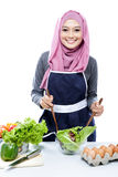 Young woman preparing making salad. Portrait of young woman preparing making salad isolated on white Royalty Free Stock Photos