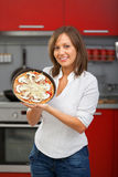 Young woman preparing pizza Stock Image