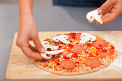 Young woman preparing pizza Stock Photo