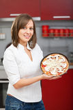 Young woman preparing pizza Royalty Free Stock Images