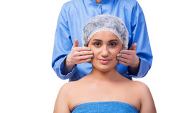 The young woman preparing for plastic surgery isolated on white Stock Image