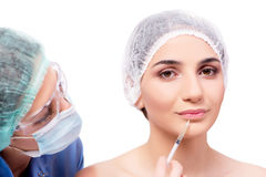 The young woman preparing for plastic surgery isolated on white Royalty Free Stock Image
