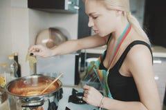 Young woman preparing pumpkin soup Royalty Free Stock Image