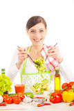 Young woman preparing salad. Royalty Free Stock Photography