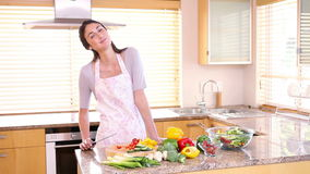 Young woman preparing a salad stock footage