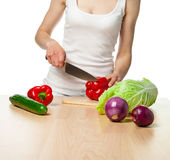 Young woman preparing salad Royalty Free Stock Image