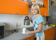 Young woman preparing tea Stock Image