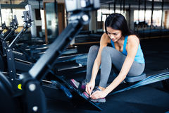 Young woman preparing to exercise on a simulator Royalty Free Stock Image