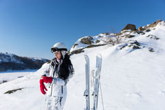 Young woman preparing to go skiing Royalty Free Stock Image