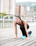 Young Woman Preparing to Run. Royalty Free Stock Photos