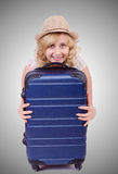 Young woman preparing for vacation Royalty Free Stock Image
