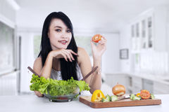 Young woman preparing vegetables salad Royalty Free Stock Image