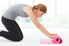 Young woman preparing for yoga. Stock Photos