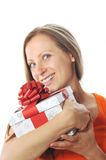 Young woman with present Stock Images