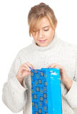 Young woman with present bag Royalty Free Stock Photo