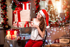 Young woman with present box on Christmas Stock Photos