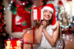 Young woman with present box on Christmas Royalty Free Stock Images