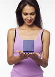 Young woman with present box in hands Stock Photo