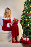 Young woman with present in christmas eve stock photo