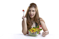 Young woman present eating salad for Healthy. Asian woman attractive pretty showing and present eating salad. Portrait of beautiful smiling and happy mixed Asian Stock Photos