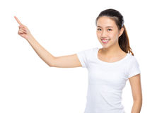 Young woman present finger up Stock Photography