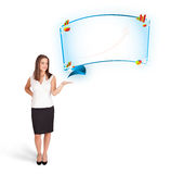 Young woman presenting abstract copy space with graphs and diagr. Ams isolated on white Royalty Free Stock Image
