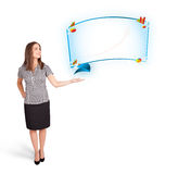 Young woman presenting abstract copy space with graphs and diagr Stock Image