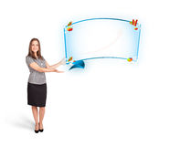 Young woman presenting abstract copy space with graphs and diagr Stock Images