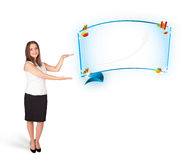 Young woman presenting abstract copy space with graphs and diagr Royalty Free Stock Images