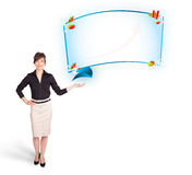 Young woman presenting abstract copy space with graphs and diagr Royalty Free Stock Image