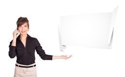 Young woman presenting abstract origami copy space Royalty Free Stock Images