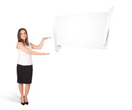Young woman presenting abstract origami copy space Royalty Free Stock Photography